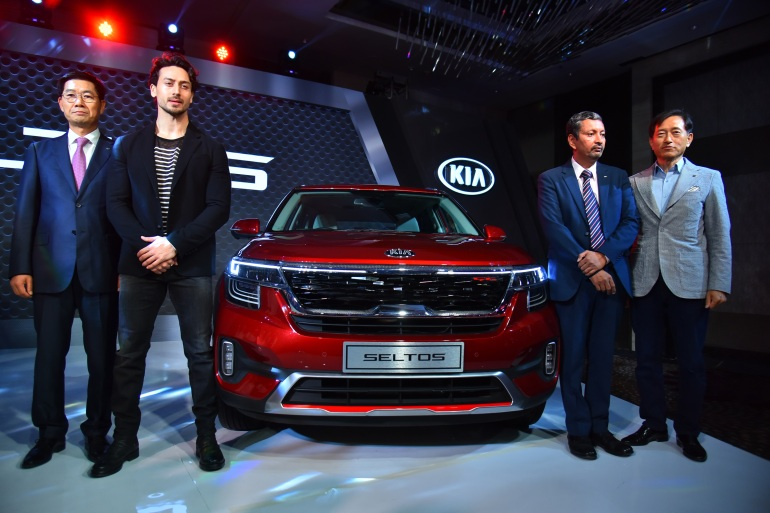 (L-R) Kookhyun Shim, Bollywood actor Tiger Shroff, Yong S Kim and Manohar Bhat at the launch of Kia Seltos