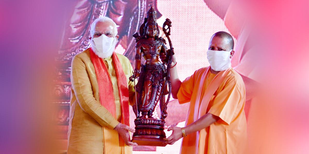 PM Narendra Modi (L) with UP CM Yogi Adityanath (R)